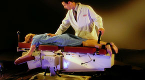 This is a picture of Cox Technic chiropratic spinal manipulation as performed at The Novelli Wellness Center.