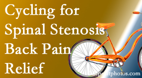 The Novelli Wellness Center encourages exercise like cycling for back pain relief from lumbar spine stenosis.