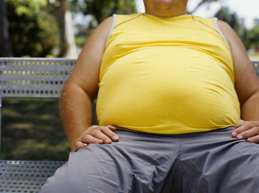 picture of overweight individual sitting on a bench